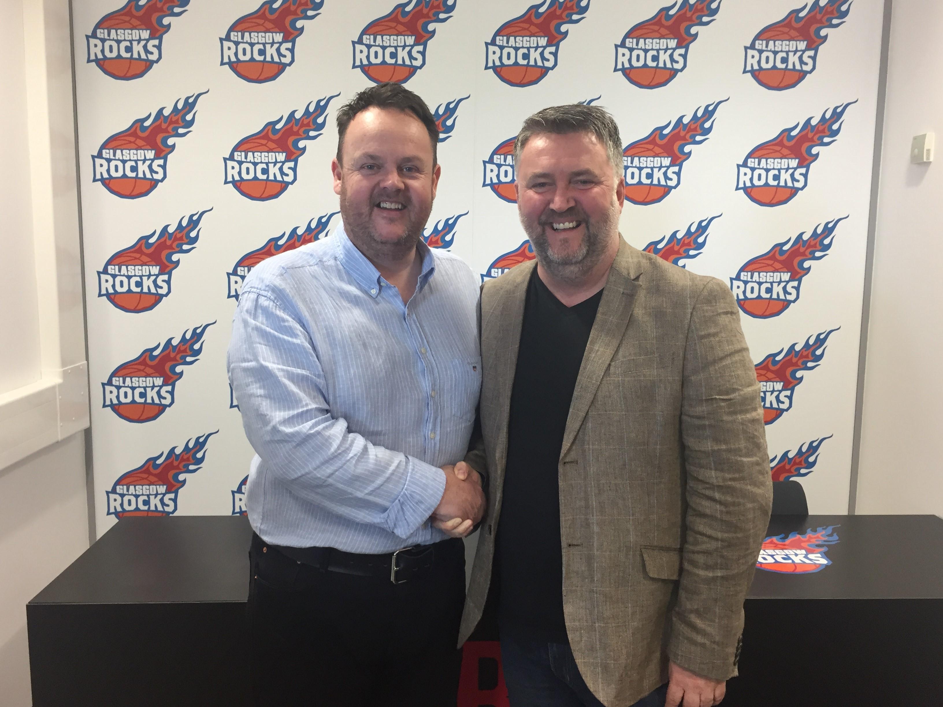 Glasgow rocks partnership handshake