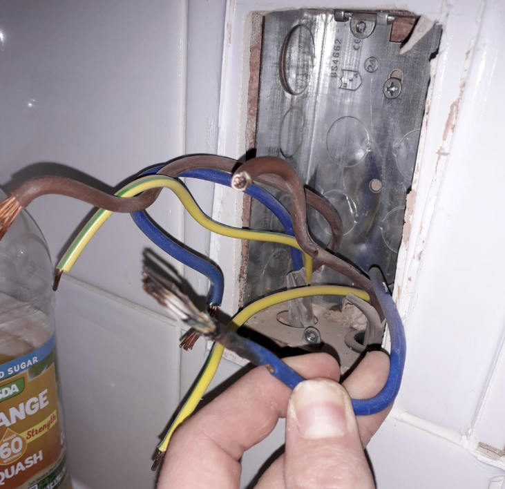 cables hanging out of electrical socket